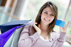 Female shopper with credit card Royalty Free Stock Photography