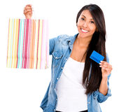 Female shopper with a credit card Royalty Free Stock Photo