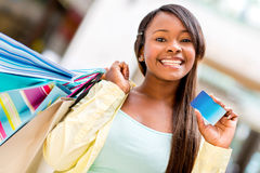 Female shopper with credit card Stock Photo