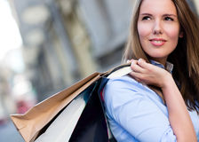 Female shopper daydreaming Royalty Free Stock Photos