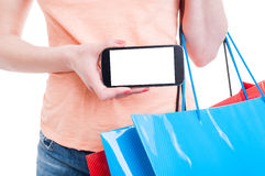Female shopper holding mobile phone with blank display Stock Photography