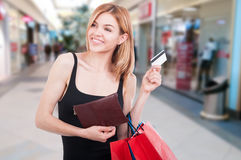 Female shopper holding shopping bags and debit card Stock Images