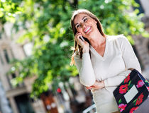 Female shopper on the phone Stock Photo