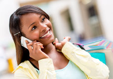 Female shopper on the phone Royalty Free Stock Image