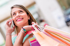 Female shopper on the phone Royalty Free Stock Photos