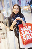 Female Shopper With Sale Bags In Shopping Mall Royalty Free Stock Photography