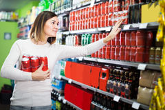 Female shopper searching for beer pack Royalty Free Stock Image