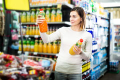 Female shopper searching for beverages Stock Photo