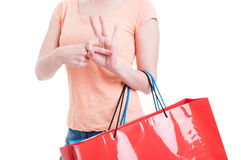 Female shopper showing sexual finger in hole gesture Royalty Free Stock Photo
