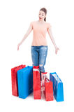 Female shopper standing and feeling enthusiastic with many shopp Royalty Free Stock Photo