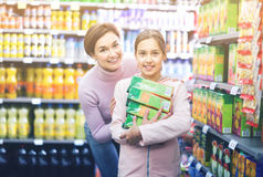 Female shopper with teenage daughter searching for beverages Stock Photos