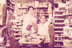Female shopper with teenage daughter searching for beverages Royalty Free Stock Image