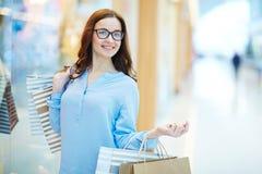 Female in shopping-center Stock Images
