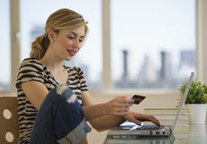 Female shopping online from home Stock Photography