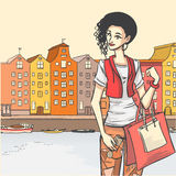 Female after shopping. Series Urban fashion. Street panorama and stylish glamour brunette woman after shopping. architectural structures, bridges Royalty Free Stock Photos