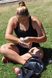 Female shot put athlete taping her wrists Royalty Free Stock Photo