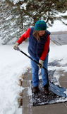 Female shoveling snow. Royalty Free Stock Photography