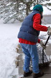 Female shoveling snow. Royalty Free Stock Photos