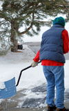 Female shoveling snow. Stock Images