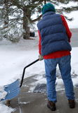 Female shoveling snow. Royalty Free Stock Image