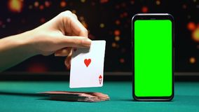 Female showing ace of hearts, black-jack card game on smartphone, application. Stock footage stock video footage