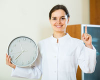 Female  showing clock Royalty Free Stock Photo