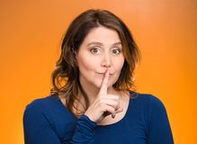 Female showing hand silence sign Stock Photos