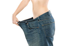 Female showing her lost weight stock photos