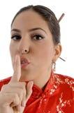 Female showing keep shushing sign Stock Images