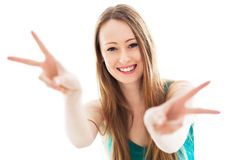 Female showing peace sign Royalty Free Stock Image