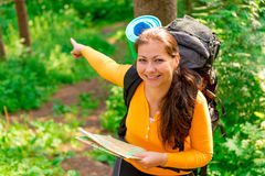 Female showing where to go. Female with a map showing where to go royalty free stock photo