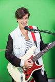 Female Signer Playing Guitar While Singing In Recording Studio Stock Images