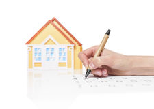 Female signing contract on a house Royalty Free Stock Image