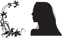 Female silhouette. And floral frame Stock Photography