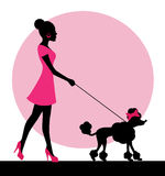 Female silhouette with a dog. On a leash Stock Photo