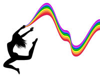 Female silhouette in a jump holds a rainbow Royalty Free Stock Image