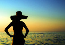 Female silhouette by the sea Royalty Free Stock Photography