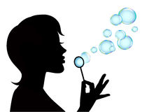 Female silhouette and soap bubbles Royalty Free Stock Images