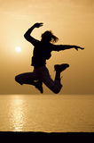 Female silhouette and sunrise Royalty Free Stock Images