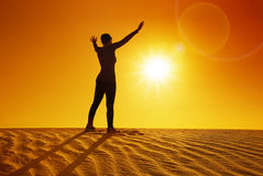 Female silhouette on top of sand dune Stock Photos