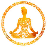 Female silhouette in yoga lotus pose. Vector silhouette of yoga woman in circle frame with bright orange texture and floral ornament. Autumn colors and tree Stock Image