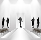 Female silhouettes on catwalk background Stock Photos