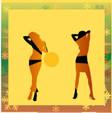 Female silhouettes dancing in a disco Stock Photos