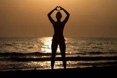Female Silhouettes Hands Making a Heart Shape Royalty Free Stock Images