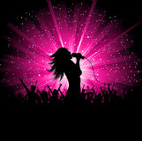 Female singer. Silhouette of a female singer performing in front of a cheering audience Stock Image