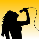 Female singer. Silhouette of a female singer Stock Photo