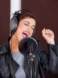 Female Singer Enjoying While Performing Royalty Free Stock Photo