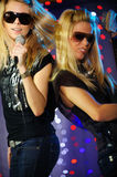 Female singer and guitar player. Rock out Royalty Free Stock Photo