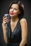 Female singer handing microphone Royalty Free Stock Photos