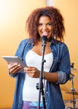 Female Singer Holding Digital Tablet While Royalty Free Stock Image